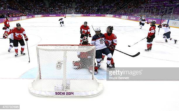 Meghan Duggan of the United States celebrates scoring a goal against Shannon Szabados of Canada during the Ice Hockey Women's Gold Medal Game on day...