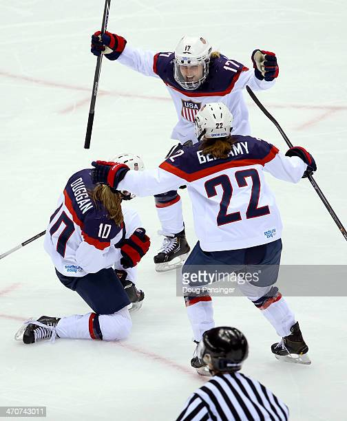 Meghan Duggan of the United States celebrates with teammates Jocelyne Lamoureux and Kacey Bellamy after scoring a second-period goal against Canada...