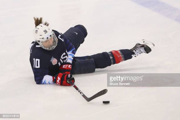 Meghan Duggan of the United States falls to the ice during warmups prior to the game against Canada during the Ice Hockey Women Playoffs Semifinals...