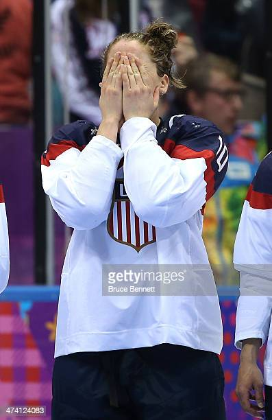 Meghan Duggan of the United States reacts during the flower ceremony after losing to Canada 3-2 during the Ice Hockey Women's Gold Medal Game on day...