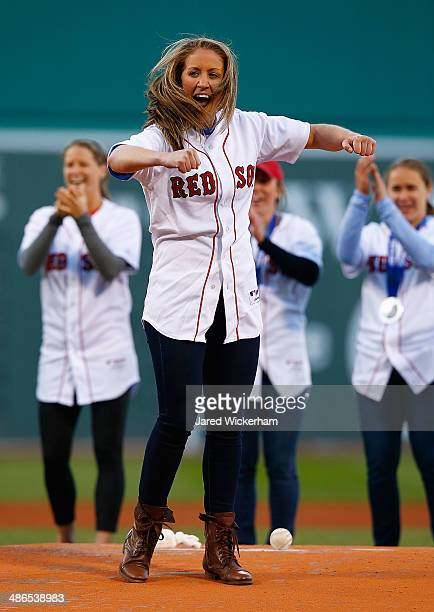Meghan Duggan US women's hockey team member throws out the first pitch prior to the game between the Boston Red Sox and the New York Yankees during...