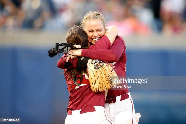 Meghan King and Anna Shelnutt of the Florida State Seminoles celebrate after defeating the Washington Huskies during the Division I Women's Softball...