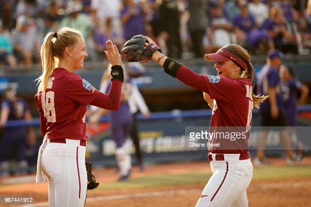 Meghan King and Cali Harrod of the Florida State Seminoles share a moment against the Washington Huskies during the Division I Women's Softball...