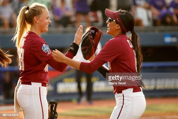 Meghan King and Zoe Casas of the Florida State Seminoles share a moment against the Washington Huskies during the Division I Women's Softball...