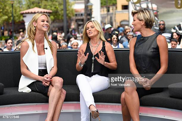 Meghan King Edmonds Tamra Judge and Charissa Thompson visit 'Extra' at Universal Studios Hollywood on July 6 2015 in Universal City California