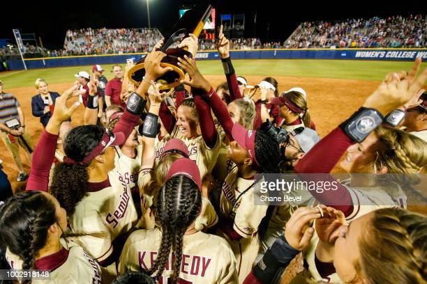 Meghan King of Florida State hoists the national championship trophy following game two of the Division I Women's Softball Championship held at USA...