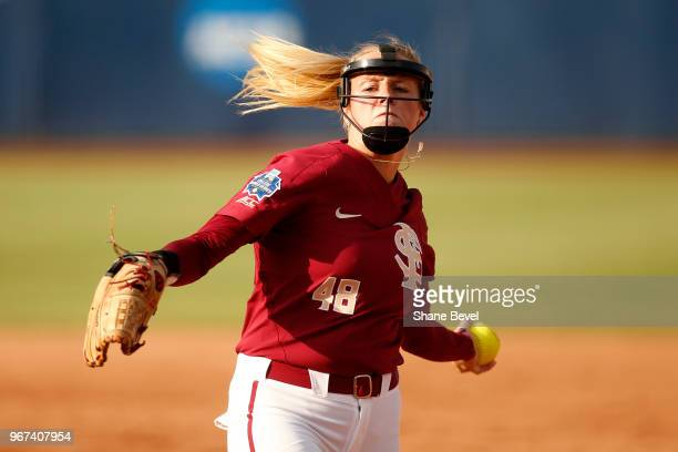 Meghan King of the Florida State Seminoles pitches against the Washington Huskies during the Division I Women's Softball Championship held at USA...