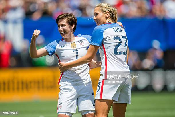 Meghan Klingenberg and Allie Long of of the US Women's National Team celebrate after Long assisted Julie Johnston on a goal during the first half of...