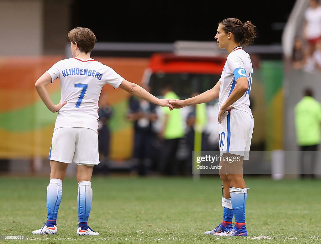 Meghan Klingenberg #7 and Carli Lloyd #10 of United States show camaraderie after the 1-1 (3-4 PSO) loss to Sweden during the Women's Football Quarterfinal match at Mane Garrincha Stadium on Day 7 of the Rio 2016 Olympic Games on August 12, 2016 in Brasilia, Brazil.