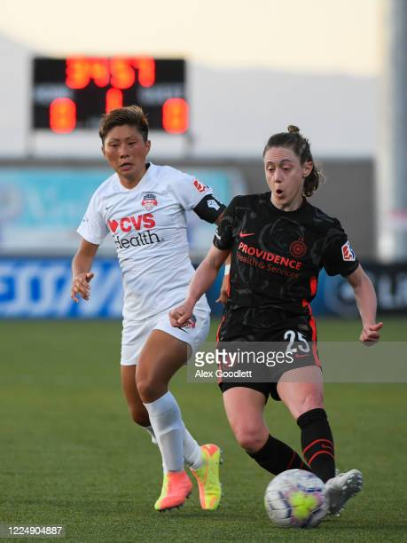 Meghan Klingenberg of Portland Thorns FC fights for the ball with Kumi Yokoyama of Washington Spirit during a game on day 5 of the NWSL Challenge Cup...
