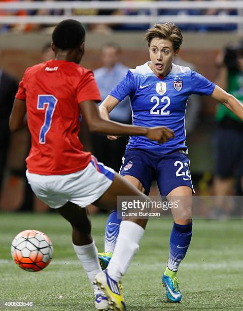 Meghan Klingenberg of the United States drives passes the ball against Roselord Borgella of Haiti during the second half of the US Women's 2015 World...