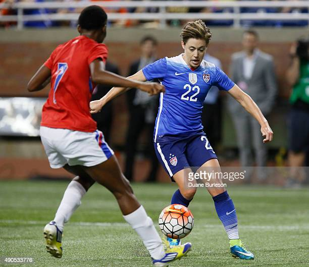 Meghan Klingenberg of the United States drives towards the goal against Roselord Borgella of Haiti during the second half of the US Women's 2015...