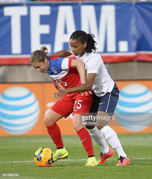 Meghan Klingenberg of the United States fights for the ball with Elodie Thomis of France during a women's international friendly match between France...