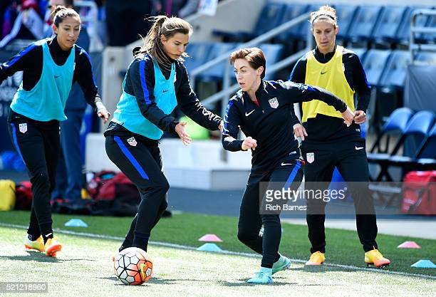 Meghan Klingenberg of the United States warms up while being defended by teammate Tobin Heath prior to the match against Colombia at Talen Energy...