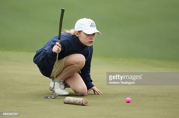 Meghan Lane of New England lines up a putt during the Girls 1011 category of the National Finals of the Drive Chip and Putt Championship at Augusta...