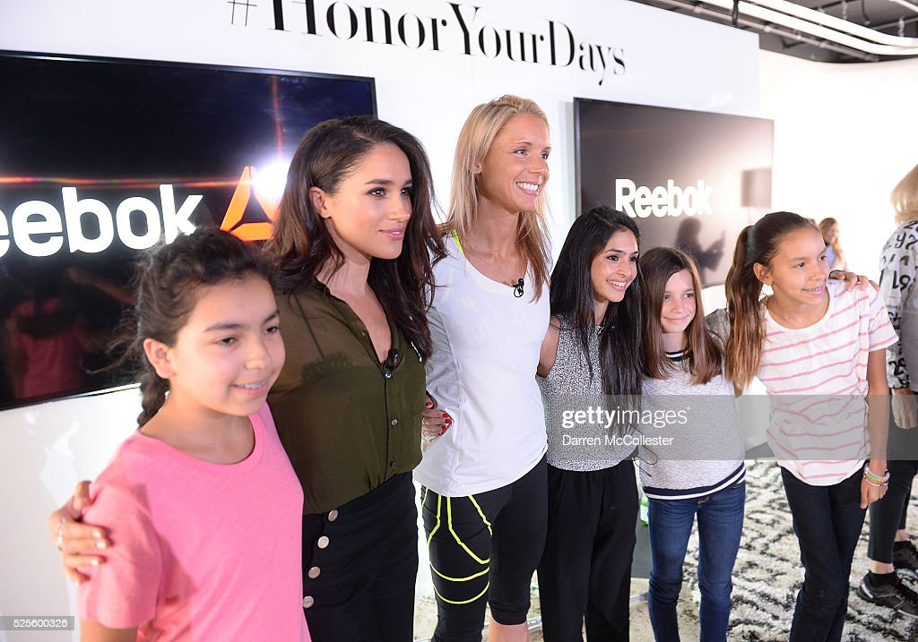 Meghan Markle, Amelia Boone and Payal Kadakia pose with fans during REEBOK #HonorYourDays Luncheon at REEBOK Headquarters on April 28, 2016 in Canton, Massachusetts.