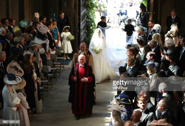 Meghan Markle and her bridal party walk down the aisle of St George's Chapel at Windsor Castle for the wedding to Prince Harry on May 19, 2018 in...