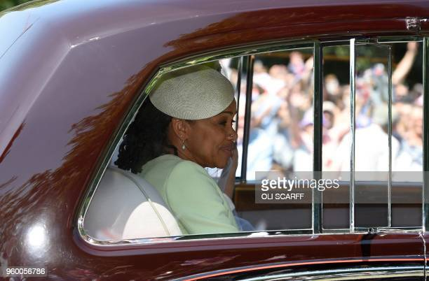Meghan Markle and her mother Doria Ragland are driven along the Long Walk as they arrive for her wedding ceremony to marry Britain's Prince Harry...