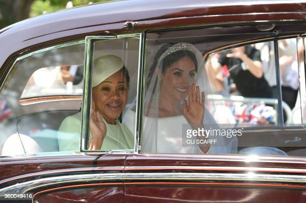 Meghan Markle and her mother Doria Ragland arrive for her wedding ceremony to marry Britain's Prince Harry Duke of Sussex at St George's Chapel...