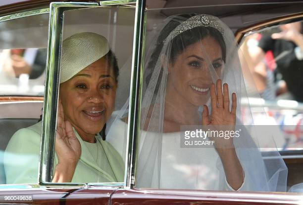 TOPSHOT Meghan Markle and her mother Doria Ragland arrive for her wedding ceremony to marry Britain's Prince Harry Duke of Sussex at St George's...