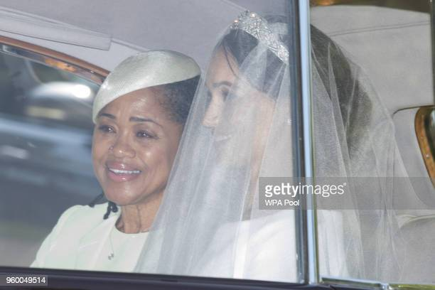 Meghan Markle and her mother Doria Ragland make their way to St George's Chapel at Windsor Castle before the wedding of Prince Harry to Meghan Markle...