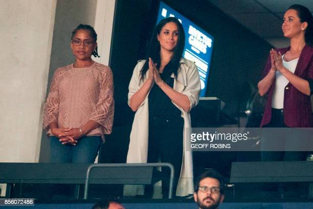 Meghan Markle and her mother Doria Radlan watch the closing ceremonies for the Invictus Games in Toronto Ontario September 30 2017 / AFP PHOTO /...