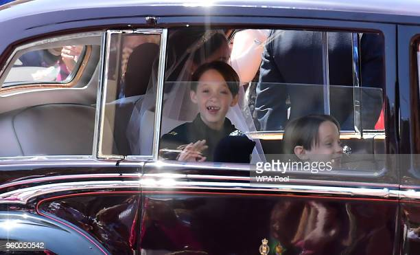 Meghan Markle and page boys arrive at St George's Chapel at Windsor Castle before the wedding of Prince Harry to Meghan Markle on May 19 2018 in...