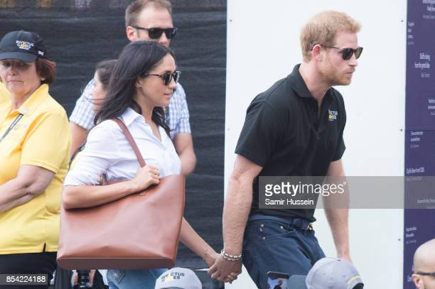 Meghan Markle and Prince Harry attend wheelchair tennis on day 3 of the Invictus Games Toronto 2017 on September 25, 2017 in Toronto, Canada. The...