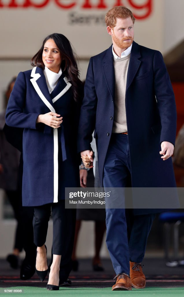 Meghan Markle and Prince Harry depart after visiting Nechells Wellbeing Centre on March 8, 2018 in Birmingham, England.