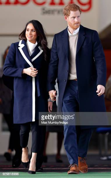 Meghan Markle and Prince Harry depart after visiting Nechells Wellbeing Centre on March 8 2018 in Birmingham England