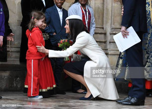Meghan Markle and Prince Harry depart from the 2018 Commonwealth Day service at Westminster Abbey and meet waiting school children on March 12 2018...
