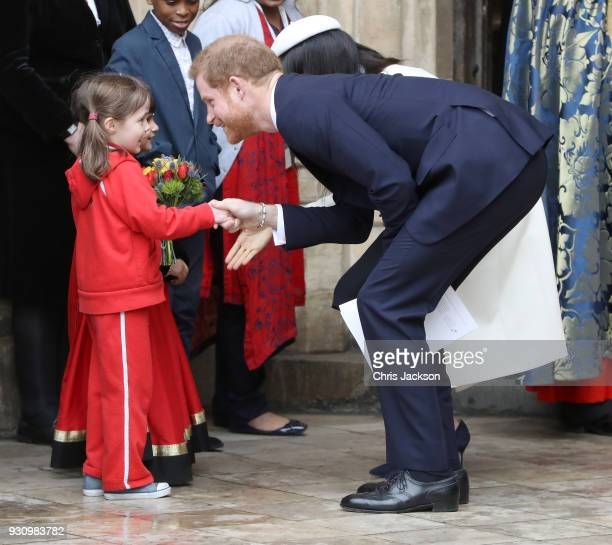 Meghan Markle and Prince Harry greet children as they depart the 2018 Commonwealth Day service at Westminster Abbey on March 12 2018 in London England
