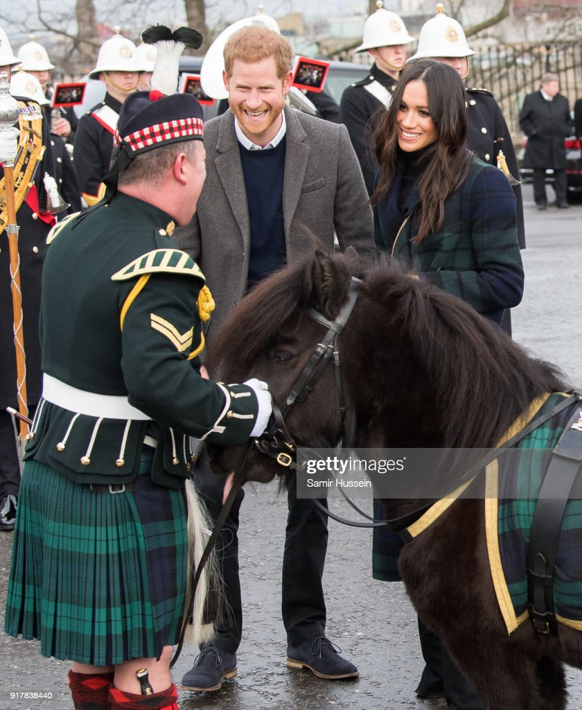 Meghan Markle and Prince Harry meet a Shetland pony as they visit Edinburgh Castle during a visit to Scotland on February 13, 2018 in Edinburgh, Scotland