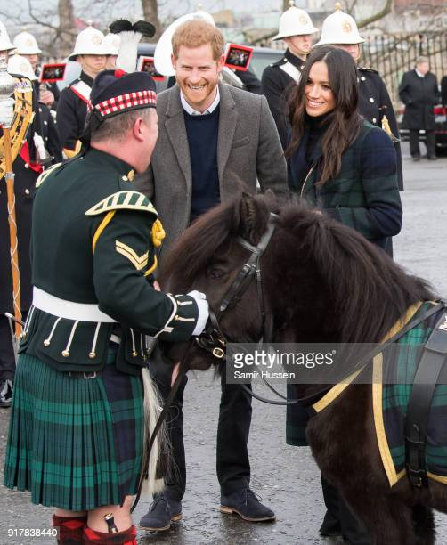 Meghan Markle and Prince Harry meet a Shetland pony as they visit Edinburgh Castle during a visit to Scotland on February 13, 2018 in Edinburgh,...