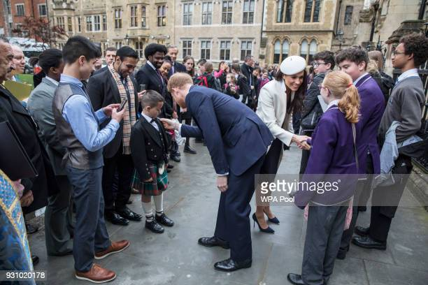 Meghan Markle and Prince Harry meet school children in the Dean's yard before attending a Reception after attending the Commonwealth Service at...