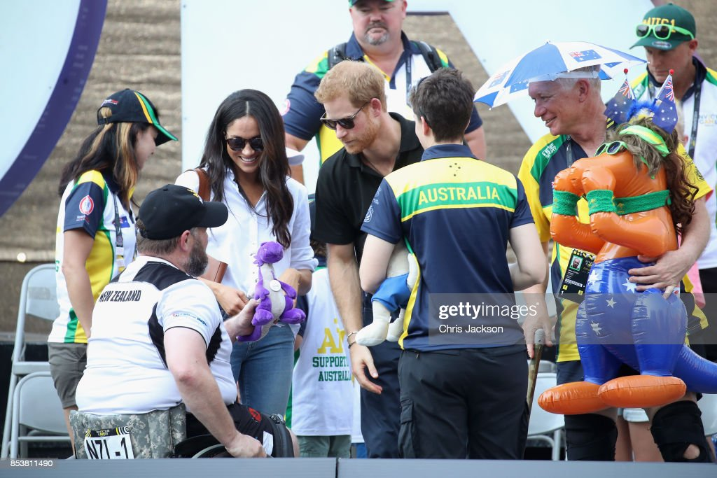 Meghan Markle and Prince Harry speak with a member of the public as she attends a Wheelchair Tennis match during the Invictus Games 2017 at Nathan Philips Square on September 25, 2017 in Toronto, Canada