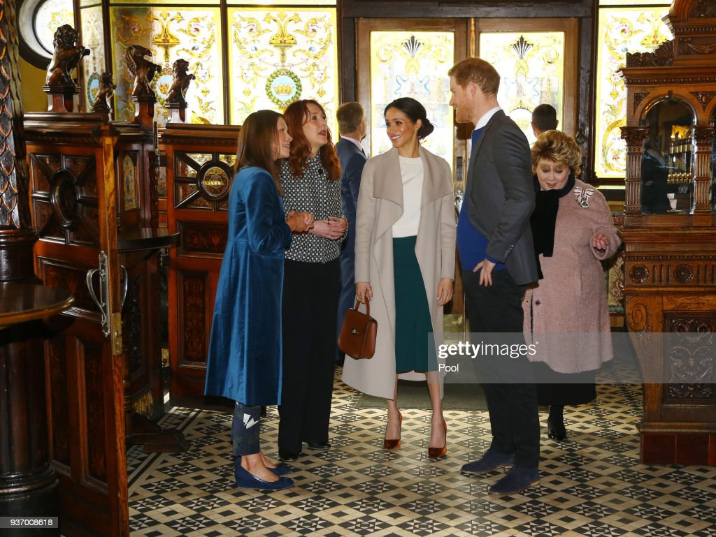 Meghan Markle and Prince Harry visit Crown Bar, a former Victorian gin palace owned by the National Trust, on March 23, 2018 in Belfast, Nothern Ireland.