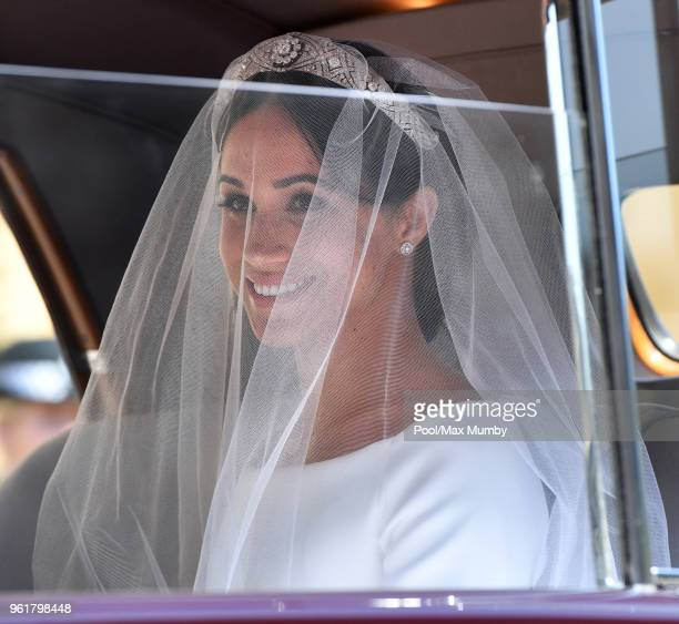 Meghan Markle arrives at St George's Chapel Windsor Castle for her wedding to Prince Harry on May 19 2018 in Windsor England Prince Henry Charles...