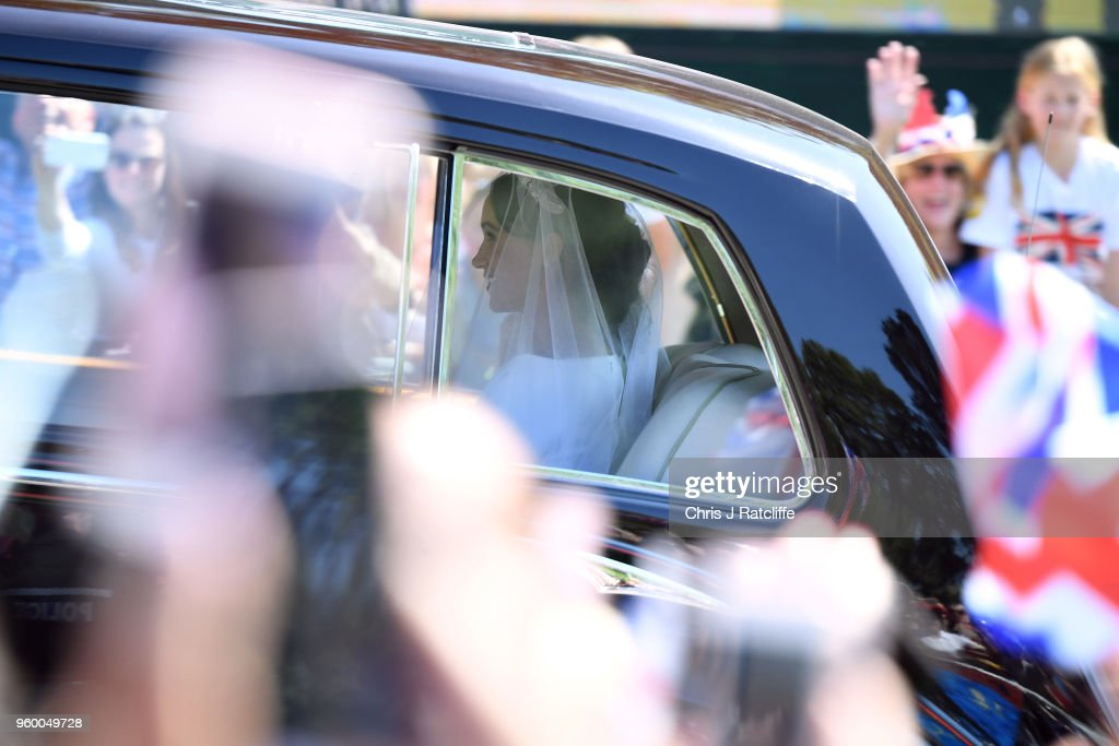 Meghan Markle arrives at Windsor Castle ahead of her wedding to Prince Harry on May 19, 2018 in Windsor, England. Prince Henry Charles Albert David of Wales marries Ms. Meghan Markle in a service at St George's Chapel inside the grounds of Windsor Castle. Among the guests were 2200 members of the public, the royal family and Ms. Markle's Mother Doria Ragland.