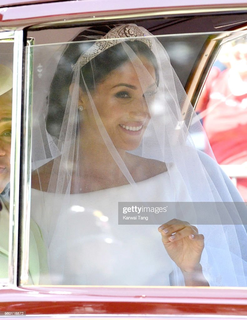 Meghan Markle arrives at Windsor Castle ahead of her wedding to Prince Harry on May 19, 2018 in Windsor, England. Prince Henry Charles Albert David of Wales marries Ms. Meghan Markle in a service at St George's Chapel inside the grounds of Windsor Castle. Among the guests were 2200 members of the public, the royal family and Ms. Markle's Mother, Doria Ragland.