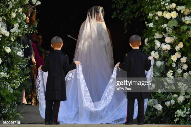 Meghan Markle arrives for the wedding ceremony to marry Prince Harry at St George's Chapel, Windsor Castle on May 19, 2018 in Windsor, England.