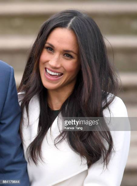 Meghan Markle attends an official photocall to announce their engagement of Prince Harry and actress Meghan Markle at The Sunken Gardens at...