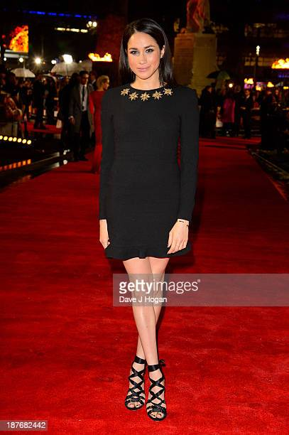 """Meghan Markle attends the UK Premiere of """"The Hunger Games: Catching Fire"""" at Odeon Leicester Square on November 11, 2013 in London, England."""