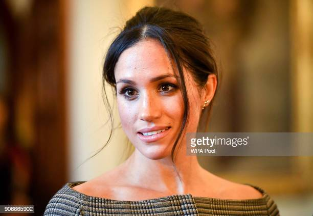 Meghan Markle chats with people inside the Drawing Room during a visit to Cardiff Castle on January 18 2018 in Cardiff Wales