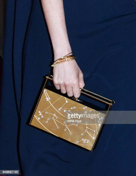 Meghan Markle clutch bag detail arrives at the Royal Albert Hall to attend a starstudded concert to celebrate the Queen's 92nd birthday on April 21...