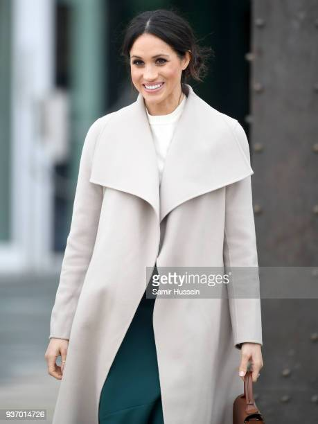 Meghan Markle departs the iconic Titanic Belfast during her visit with Prince Harry to Northern Ireland on March 23 2018 in Belfast Northern Ireland...