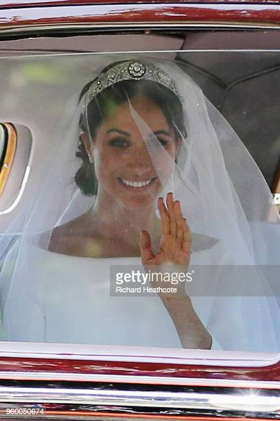 Meghan Markle drives down the Long Walk as they arrive at Windsor Castle ahead of her wedding to Prince Harry on May 19 2018 in Windsor England