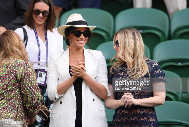 Meghan Markle Duchess of Sussex watches on during the ladies' Singles Second round match between Serena Williams of The United States and Kaja Juvan...
