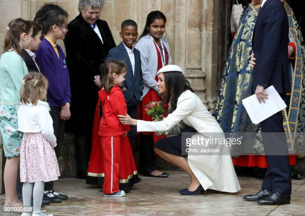Meghan Markle greets a child as she departs from the 2018 Commonwealth Day service at Westminster Abbey on March 12 2018 in London England