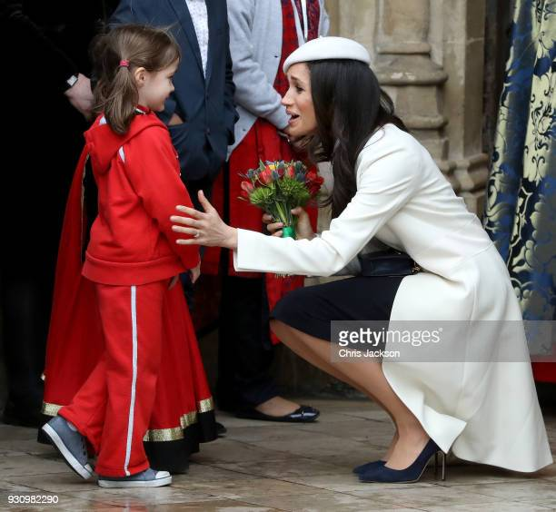 Meghan Markle greets a child as she departs the 2018 Commonwealth Day service at Westminster Abbey on March 12 2018 in London England